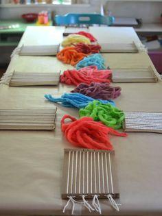 Kids dye their own chunky wool yarn with Koolaid, then make small weaving on cardboard looms.