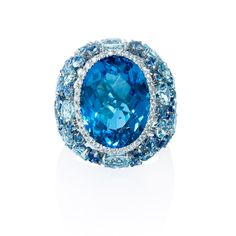 NEW: Reminiscent of sparkling ocean blue water, this right hand ring is comprised of 1 brilliantly faceted blue topaz 13.35ctw, 42 blue sapphires 2.34ctw and 22 aquamarine stones 4.75ctw of exquisite color. A halo accent of round brilliant white diamonds surrounds the center. $2,570
