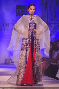 Sonalika Sahay showcases a creation by designer Anamika Khanna on Day 2 of Delhi Couture Week, held in New Delhi, on August 01, 2013.