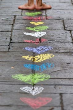 leaving her mark by *sapa*, via Flickr.  put your heart in everything you do. hearts. sidewalk chalk. feet. photography.