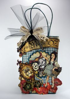 For Casie.I love this Graphic 45 scrapbooking company. The Wizard of Oz line is sooo cute, and I can't wait to make this cute little trick or treat bag. Scrapbooking Layouts, Scrapbook Paper, Wizard Of Oz Gifts, Magic Of Oz, Decorated Gift Bags, Whimsical Halloween, Trick Or Treat Bags, Handmade Birthday Cards, Handmade Cards