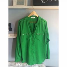 Calvin Klein shirt Lightly used. Green trimmed with silver buttons and zippers Calvin Klein Tops Blouses