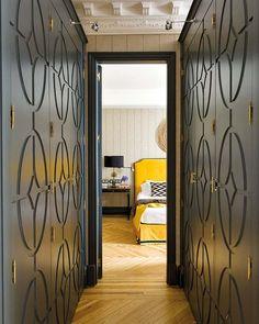 Closet doors + hardware + blue steel paint - designed by Soledad Suárez de Lezo, image via Nuevo Estilo
