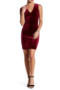This stunning velvet v-neck bodycon dress makes for a great Valentine's Day ensemble.