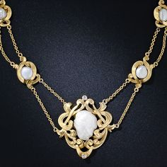 An enchanting and extraordinary Art Nouveau necklace - circa 1900. Five lustrous, cloud-like, freshwater pearls are elegantly presented in sinuous, textured gold frames rendered in consummate Art Nouveau fashion. A pair of tiny twinkling old mine-cut diamonds punctuate the top and bottom of the centerpiece of this rare and uniquely beautiful jewel. This snug fitting choker necklace measures 14 inches, but an extender can easily be added to the back of the neck chain.