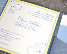 This blue and yellow wedding invitation shows how an invitation can be traditional and modern at the same time.