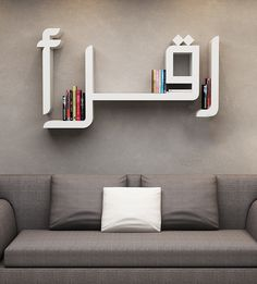 Iqra' Bookcase - Store your books in a typographic bookcase that spells out 'Iqra', the Arabic word for read.