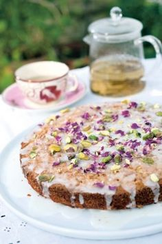 Pistachio cake with lemon icing. This cake is adapted from a much-loved Nigel Slater recipe. It's rich, nutty and scented, and completely beguiling. I have used polenta inst...