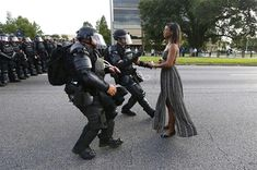 A demonstrator protesting the shooting death of Alton Sterling is detained by law enforcement near the headquarters of the Baton Rouge Police Department in Baton Rouge, Louisiana, U. July Black Lives Matter: The Baton Rouge photo hailed as 'legendary' Evans, Baton Rouge Protest, World Press Photo, Powerful Images, Powerful Women, Iconic Photos, Katie Holmes, 2017 Photos, 2016 Pictures