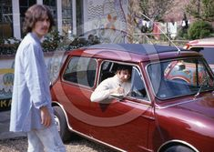 Drive my car: George and Ringo Starr outside Harrison's Surrey home reportedly on the day...