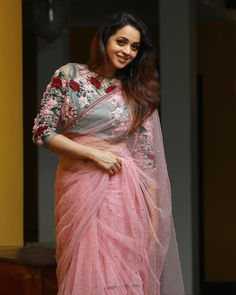Bhavana in a bridal look in a pink color sheer saree and floral three quarter sleeves blouse design with embroidery work Simple Sarees, Trendy Sarees, Fancy Sarees, Party Wear Sarees, Saree Blouse Patterns, Saree Blouse Designs, Kurti Patterns, Indian Designer Outfits, Designer Dresses