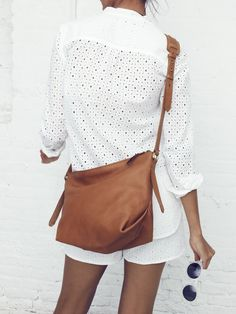 Madewell tunic popover worn with eyelet shorts + the Sutton hobo.