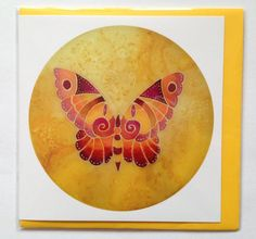 A colourful, abstract butterfly design in oranges, browns, reds and yellows, taken from an original silk-painted sun catcher and printed onto