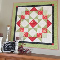 Carried Away Quilting makes a red and green Moda Love Quilt for Christmas.