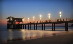 lighting up the Pier -- photo by Jenna Finch News South Africa, Durban South Africa, Most Beautiful Beaches, Beautiful Places, Great Places, Places Ive Been, City By The Sea, Kwazulu Natal, South Africa