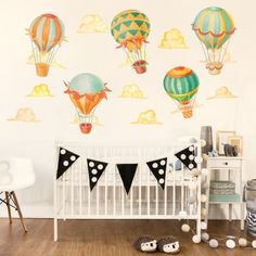 Our Up & Away Hot Air Balloon Watercolor Wall Decal Kit creates adventure, color and whimsy in any room. This kit includes 5 Hot Air Balloons and 7 puffy clouds , all Illustrated in Watercolor and Ink.