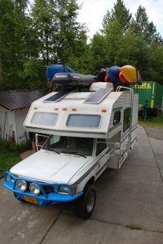 Living in a Van down by the River!: Winter RV living in Alaska update. - check out the kayaks and solar panels on roof Toyota Motorhome, Toyota Camper, Mini Motorhome, Toyota Trucks, Truck Camper, Camper Van, Cabover Camper, Toyota Dolphin, Rv Solar Panels