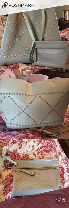 Reversible Altar'd State Handmade Leather bag/tote Reversible Altar'd State Handmade Leather bag/tote, gray to mint, comes with wristlet, super cute Aztec leather weave design on both sides, love this bag! Altar'd State Bags Totes