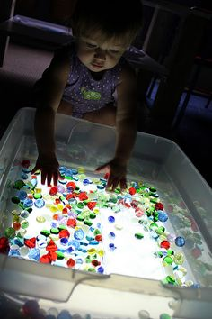 Reggio Emilia inspired light table play from Play at Home Mom