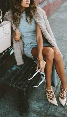 Lace up heel + faux fur.
