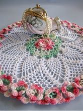 handvase and doily oh my! Wonderful handvase has lily of the valley on it, own-lefton (not my photo)