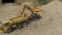 These are tiny model RC bulldozers and dump trucks. A man in Canada has been excavating his basement for about seven years using only miniature vehicles, including diggers and transports. Check out the link for more details! I would love to see this itty bitty construction site in person.