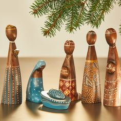 Graceful and serene, this nativity has been hand-carved and painted by makers in Indonesia. Pekerti Foundation works to supplement the income of subsistence farmers and rural families through development and helping them sell their traditional crafts. This set features a locally popular stippled dot effect.