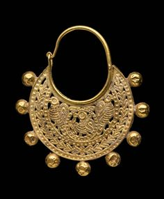 Pair of openwork earrings; Byzantine;  6th or early 7th century A.D.; Crescent-shaped with 9 spheres on lower edge. Bird pecks at plant in center roundel. Pair of birds flanks roundel. Wreath follows loweredge.