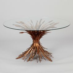 Mid Century Gilded Metal Wheat Sheaf Table  --  Circa 1940s cocktail or side table has a gilded metal base in the form of gathered wheat sheaves with a round glass table top. Found in Europe - probably originates from Italy.  --   Item:  7014  --  Retail Price:   $2495