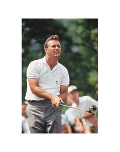 "Arnold Palmer In the early 1960s, Arnold Palmer was more than a golfer: He was a superstar—the Elvis Presley of sports. With his horde of fans (Arnie's Army) and his pomaded pompadour, Palmer brought golf to the masses. He could dress, too, favoring flat-front gabardine pants with a heavy crease and wool cardigans. And those fitted golf shirts: ""There was some talk that maybe my muscles were too big for the shirts,"" Palmer admits today. But sportswriter Frank Deford has testified that…"