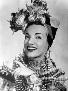 """CARMEN MIRANDA ~ Born: Feb 9, 1909 in Portugal. Died: Aug 5, 1955 (aged 46) of a heart attack. Was best known for her musical numbers where she wore a costume featuring a hat decorated with fruit. In 1940 Carmen was signed to appear in the Twentieth Century-Fox production """"Down Argentine Way"""". Starred in """"That Night in Rio"""" (1941), """"Springtime in the Rockies"""" (1942). Carmen made one film each in 1945, '46, '47 and '48. Her final performance on the silver screen was """"Scared Stiff"""" (1953)"""