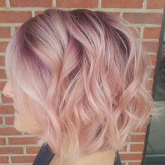 Rose gold hair with purple root extention by me! Also a little splash of blonde at the front!