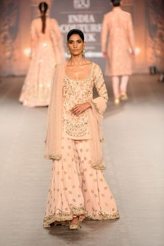 Light pink embroidered Shyamal Bhumika Sharara - - Shyamal Bhumika ICW 2018 collection consisted of some stunning bridal lehengas, grooms wear sherwanis, tons of wedding guest outfits and loads of Indian Wear designs. Every year, Shyamal & Bhumika…. Dress Indian Style, Indian Dresses, Indian Outfits, Sharara Designs, Designer Bridal Lehenga, Indian Designer Outfits, Designer Dresses, Indian Designers, Ethnic Fashion