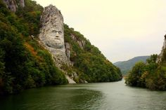 Rock statue of King Decebal on the Danube River, Romania; The Statue of Dacian king Decebalus is a high statue that is the tallest rock sculpture in Europe. It is located on the Danube's rocky bank, near the city of Orşova, Romania. Oh The Places You'll Go, Places To Travel, Places To Visit, Wonderful Places, Beautiful Places, Visit Romania, Danube River, Beautiful World, Wonders Of The World