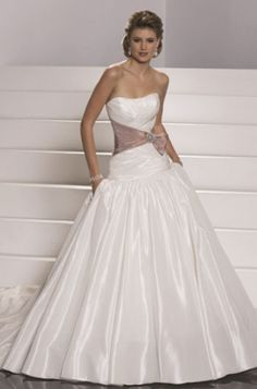 This ballgown, designed by Sottero & Midgley, style #Jayne,  is available in a size 12, and is all over ivory in color.  Details include a corset back, unique belt that defines waist. and already bustled.  Priced at $450.00. (Store Style #W0374)