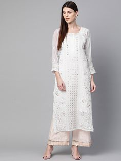 Ada Hand Embroidered White Faux Georgette Lucknow Chikankari Kurti With Slip – A100413 offers a comfortable and relaxed silhouette to the wearer #AdaChikan #chikan #chikankari #traditional #handcrafted #lucknowi