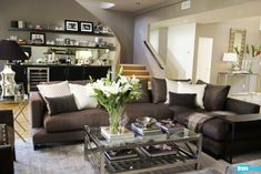 Jeff Lewis' choice of a darker sofa blends so well into the overall design, it allows for other design elements to pop.