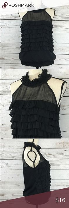 """Takara Black Ruffled Halter Blouse Elastic Waist Beautiful black ruffled, halter blouse with an elastic waistband. The tag says Takara but the hanger straps say My Michelle. Excellent used condition. Bust: 35""""; Length from under the arm to the bottom hem: 16"""". Measurements are approximate. Smoke free home. 🌺Thanks for shopping my closet😊🌺 Takara Tops Blouses"""