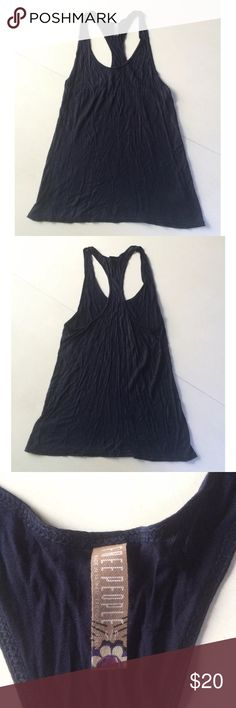 "Free people tank top shirt sleeveless blue This is a lovely tank top by Free People. It is navy blue with a shimmer. It is very light weight and super soft. Size S. 100% modal. Hand wash, dry flat.  Arm pit to arm pit: 14""-19"" Waist: 14.5""-19.5"" Arm pit to hem: 14.5"" Free People Tops Tank Tops"