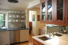 hanging white kitchen shelves black countertop stainless steel appliances white drawer system hanging wood cabinets with glass door white stone tiles backsplash undermount sink in square sh of Dislike Mainstream Kitchen Shelving? These Tens Industrial Kitchen Shelving Ideas Might Be Your Favorite