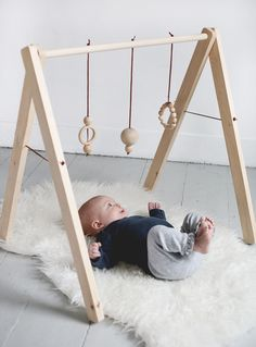 DIY Wooden Baby Gym @themerrythought I will be making this this summer!! Perfect project for the kids to help with.