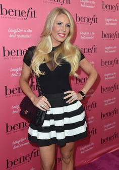 Gretchen Rossi in black and white striped skirt and black top