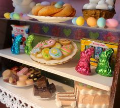 Close up miniature Easter cookies, chocolate bunnies, colored eggs display.   Flickr - Photo Sharing!
