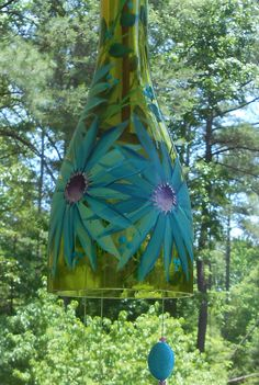 Only small size wine bottle availble and ready to mail Small .750 liters ( has 3 singe ring that make up the chimes) All Wine-Chimes are made from recycled wine bottles. The chime is put together with 40-pound nylon line, leather lace, cork, and beads . All Wine-Chimes are made from