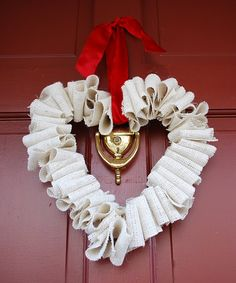 Valentine Wreath.  Did a variation of this with red burlap for a Super Saturday project.  Twisted the burlap differently also so it didn't just look folded.