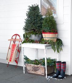Vintage sled, crates & Christmas  trees on the porch