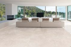 A very chic white porcelain tile which looks superb in this stunning contemporary lounge area.  #white #porcelain #tiles