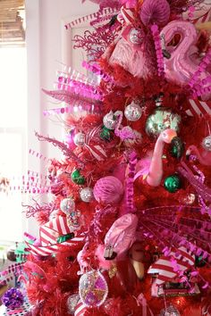 Fabulous tree decorated with honeycomb balls, garlands, and flamingos!