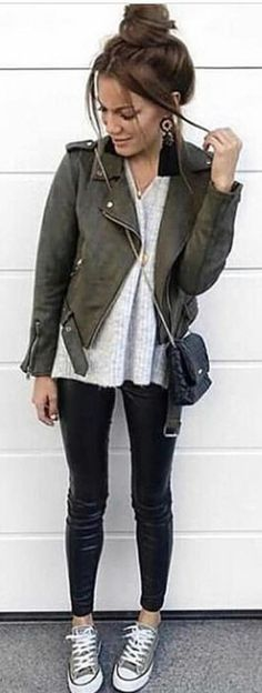 #spring #outfits woman wearing black leather bikers jacket, black leggings, and sneakers outfit. Pic by @europeantrends