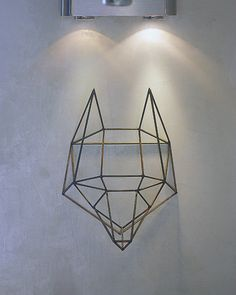 Copper wall installation, the trophy head of a wolf, ideal for the modern loft space.